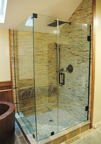 Frameless enclosure with swinging glass shower doors, Los Angeles, CA